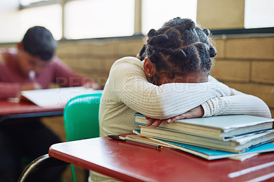 Buy stock photo Shot of a young girl sleeping at her desk in a classroom