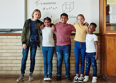 Buy stock photo Shot of a group of young children standing together in a classroom