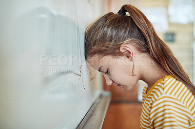 Buy stock photo Shot of a young girl leaning against a board in a classroom at school