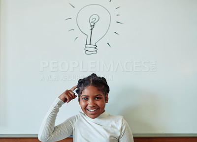 Buy stock photo Shot of a young girl standing in front of a board with an illustrated lightbulb in a classroom