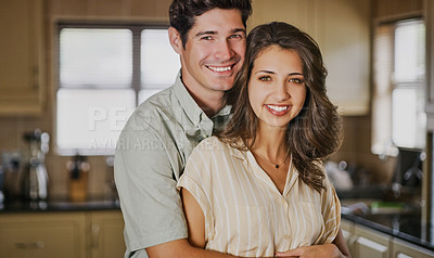 Buy stock photo Cropped shot of a loving young couple standing together at home