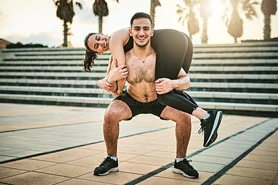 Buy stock photo Portrait of two sporty young people having fun while exercising together outdoors