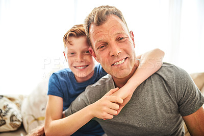 Buy stock photo Portrait of a happy father and son spending some quality time together at home