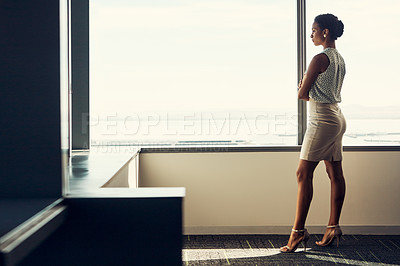 Buy stock photo Full length shot of an attractive young businesswoman posing with her arms folded while standing in her office