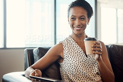 Buy stock photo Portrait of a young businesswoman drinking coffee and using a digital tablet while sitting on a couch in her office