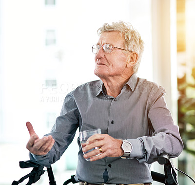 Buy stock photo Shot of a senior man taking his medication with a glass of water