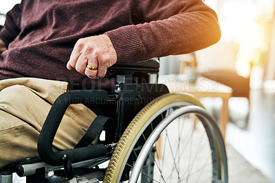 Buy stock photo Cropped shot of an unrecognizable senior man sitting in a wheelchair
