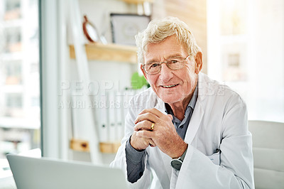 Buy stock photo Cropped shot of a senior doctor sitting in his office