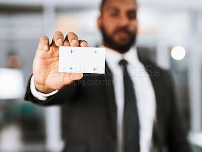 Buy stock photo Closeup shot of a businessman holding a blank business card in an office