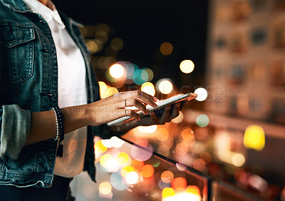 Buy stock photo Closeup shot of an unrecognisable businesswoman using a digital tablet outside at night