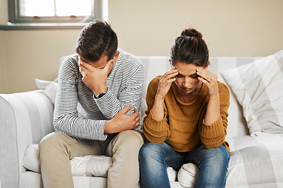 Buy stock photo Cropped shot of a young couple having an argument at home