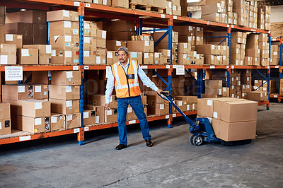 Buy stock photo Shot of a mature man doing moving boxes in a warehouse