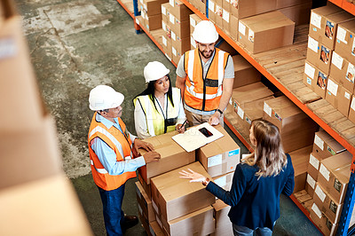 Buy stock photo High angle shot of a group of factory workers having a discussion in a warehouse