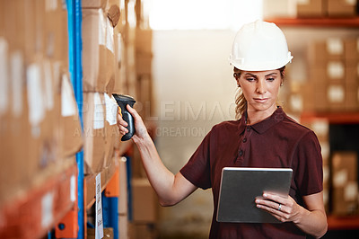 Buy stock photo Shot of a young woman using a barcode reader and digital tablet in a warehouse