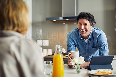 Buy stock photo Shot of a mature couple having breakfast together at home