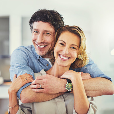 Buy stock photo Portrait of an affectionate mature couple spending quality time at home