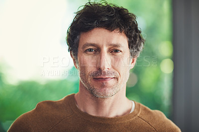 Buy stock photo Portrait of a confident mature man standing in his home