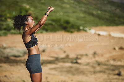 Buy stock photo Shot of a sporty young woman cheering after finishing her workout