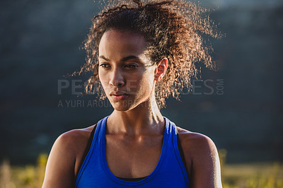 Buy stock photo Cropped shot of a sporty young woman out for a run