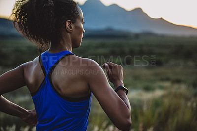 Buy stock photo Cropped shot of a sporty young woman running outdoors