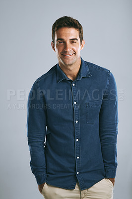 Buy stock photo Cropped shot of a handsome man posing against a grey background