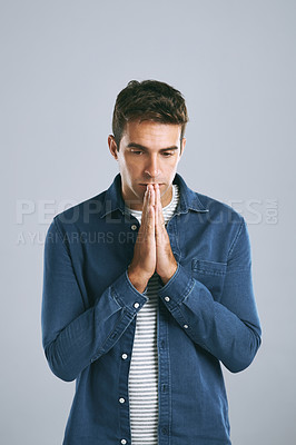 Buy stock photo Cropped shot of a handsome man looking anxious against a grey background