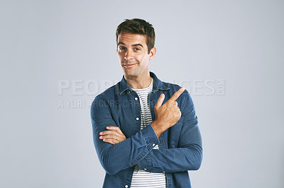 Buy stock photo Cropped shot of a man pointing up against a grey background
