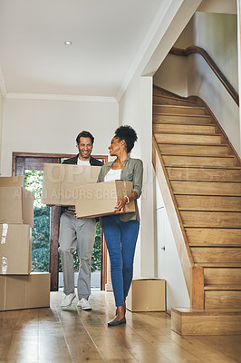 Buy stock photo Full length shot of an affectionate young couple smiling while carrying boxes into their new home