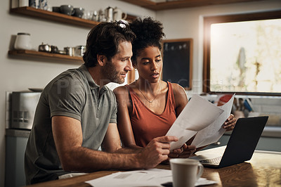 Buy stock photo Cropped shot of an affectionate young couple going through paperwork while doing their budget at home