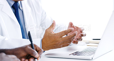 Buy stock photo Closeup shot of a group of doctors using a laptop during a meeting in a hospital boardroom
