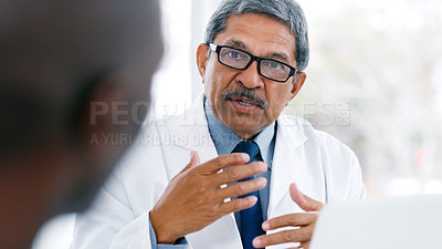 Buy stock photo Shot of a mature doctor having a meeting in a hospital boardroom