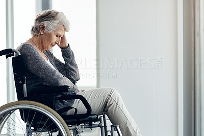 Buy stock photo Cropped shot of a senior woman sitting in a wheelchair