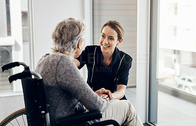Buy stock photo Cropped shot of a female nurse caring for a senior woman in a wheelchair