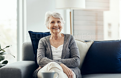 Buy stock photo Shot of a senior woman relaxing on the sofa at home