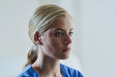 Buy stock photo Shot of an attractive young nurse working in a clinic