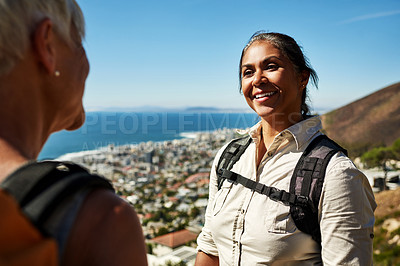 Buy stock photo Cropped shot of a mature woman out hiking with a friend on a sunny day