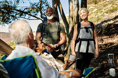 Buy stock photo Shot of a group of senior people enjoying themselves while hiking out in the mountains