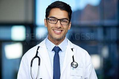 Buy stock photo Portrait of a young doctor standing in a hospital