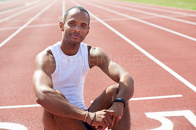 Buy stock photo Portrait of a mature male sprinter sitting down on a track