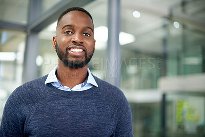 Buy stock photo Portrait of a handsome young businessman standing inside his office at work