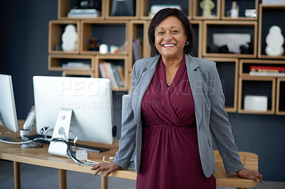 Buy stock photo Portrait of a cheerful mature businesswoman standing inside her office