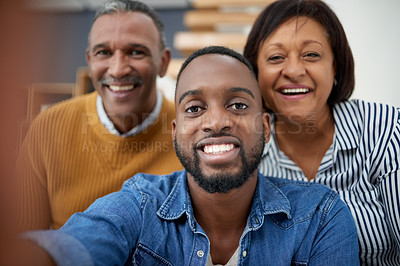 Buy stock photo Portrait of a young man taking a selfie with his parents at home