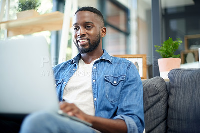 Buy stock photo Cropped shot of a handsome young man chilling on the sofa at home