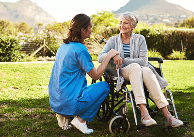 Buy stock photo Cropped shot of a young female nurse outside with a senior patient