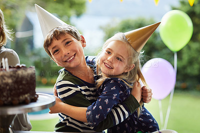 Buy stock photo Shot of a happy brother and sister celebrating a birthday at home in the garden