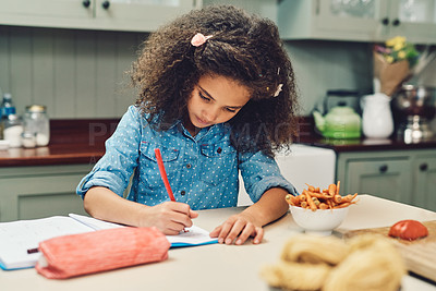 Buy stock photo Cropped shot of a young girl doing her homework at home