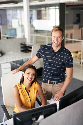 Buy stock photo Cropped portrait of two business colleagues working together in their office
