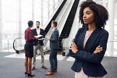 Buy stock photo Cropped shot of an attractive young businesswoman looking away thoughtfully in an office with her colleagues in the background