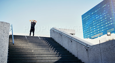 Buy stock photo Rearview shot of a young man running up stairs in the city