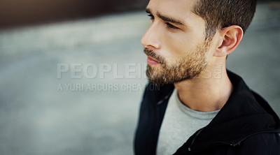 Buy stock photo Shot of a young man going for a workout in the city